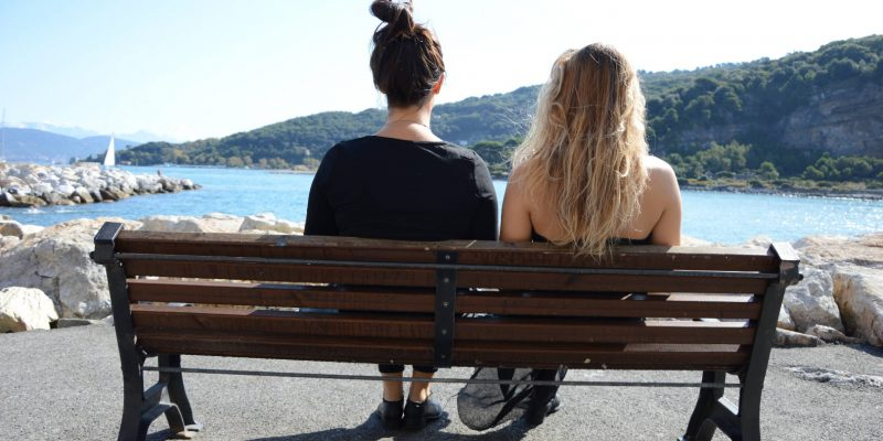 Two sisters on a bench in Portovenere, Italy