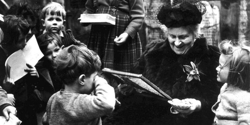 Maria Montessori with children